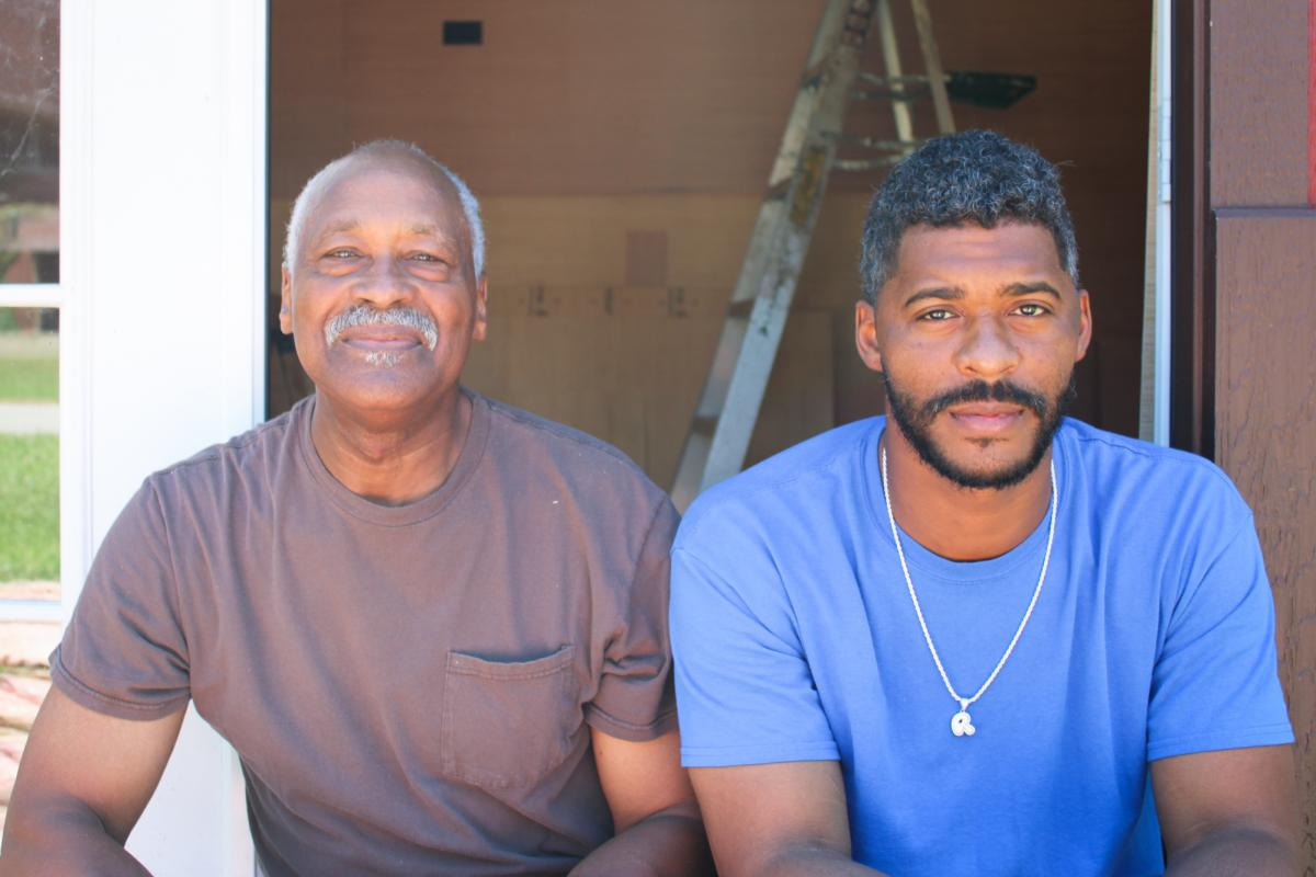 """Earlier this summer, Cairo residents Lee Wright and son Roman Wright took a break from their construction work for a photo. Both men had decided not to get vaccinated. """"I'm like my dad,"""" Roman Wright says. """"I was born and raised in church all my life. So"""