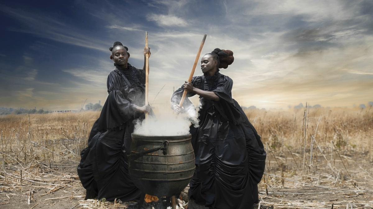 In That Evening Sun Goes Down, two women stir a large cooking pot — an African vessel still used to prepare food for large gatherings.