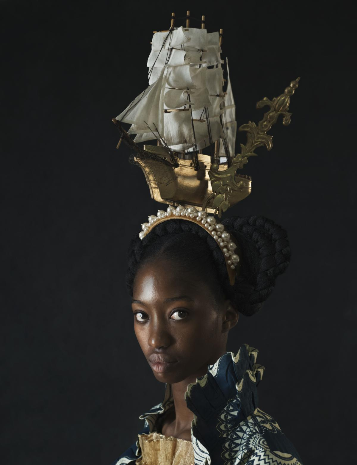"""Vessel. This headdress was inspired by the children's book """"The Lady With A Ship on Her Head,"""" says Kudita. The ship, she says, is a reminder of the transport of slaves but also can provide passage to a future free of oppression."""