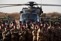 French soldiers listen to the country's defense minister in January 2015 at a French base outside the northern Mali city of Gao. The French military routed a radical Islamist group from large parts of northern Mali in 2013 and have remained to assist the