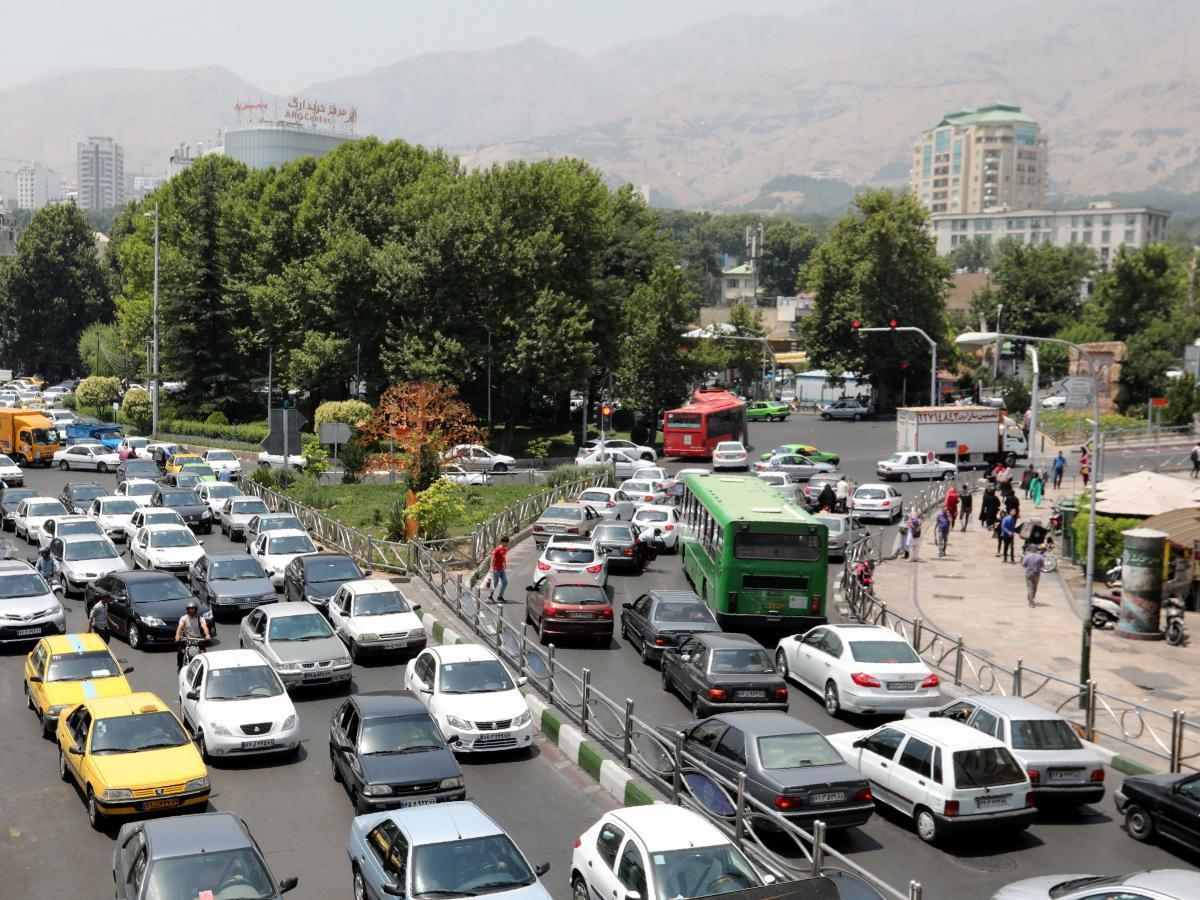 Cars drive through a busy road in Tehran last July. Manufacturing — including automobiles, metals and plastics — accounts for about a fifth of overall employment in Iran.