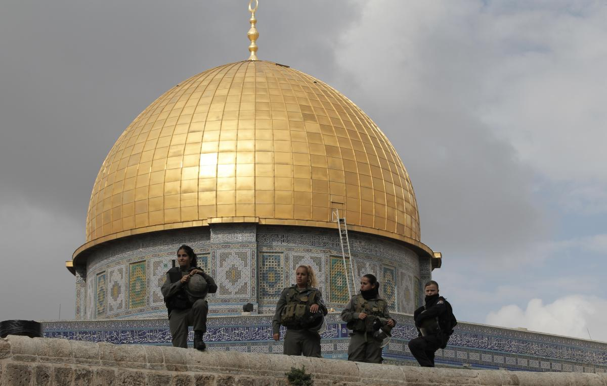 Israeli security forces stand guard near Jerusalem's Dome of the Rock mosque in the Haram al-Sharif compound, one of the holiest sites in Islam. It's also the most sacred place in Judaism. Israeli police clashed with stone-throwing Palestinians inside a n