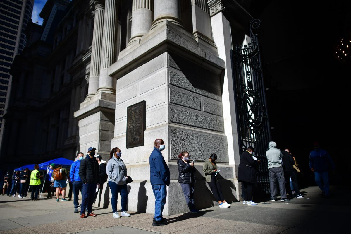 Voters queue outside Philadelphia City Hall to cast their early voting ballots on Oct. 27.