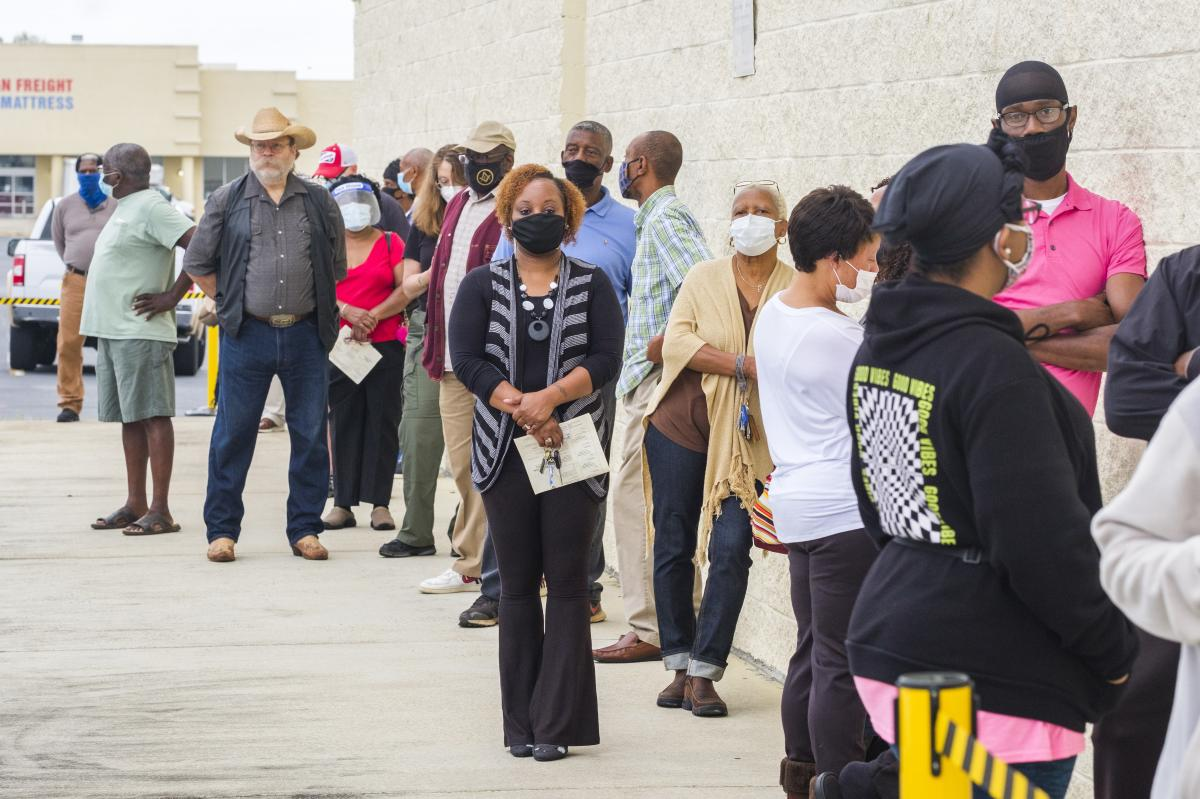 The line to vote outside the Macon-Bibb County Board of Elections in Georgia stretched around the building and lasted an hour and a half on the first day of early voting in October 2020.