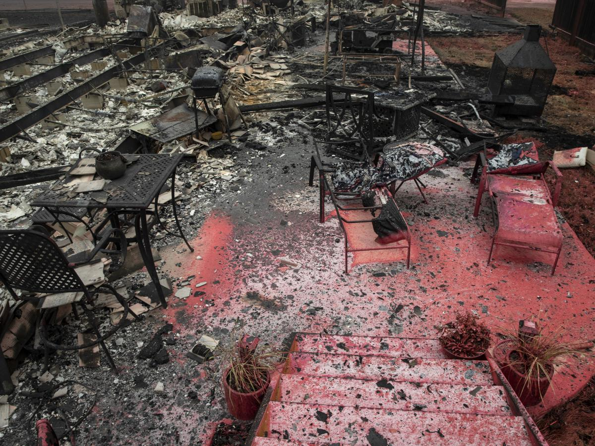 A burned residence is seen as destructive wildfires devastate the region on Friday in Talent, Ore.