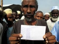 """Saliou Iya holds a handwritten list of herds of cows he says that Christian militias killed. Muslims are the country's herders. """"My father was a cowboy,"""" Iya says. """"I was born a cowboy."""""""