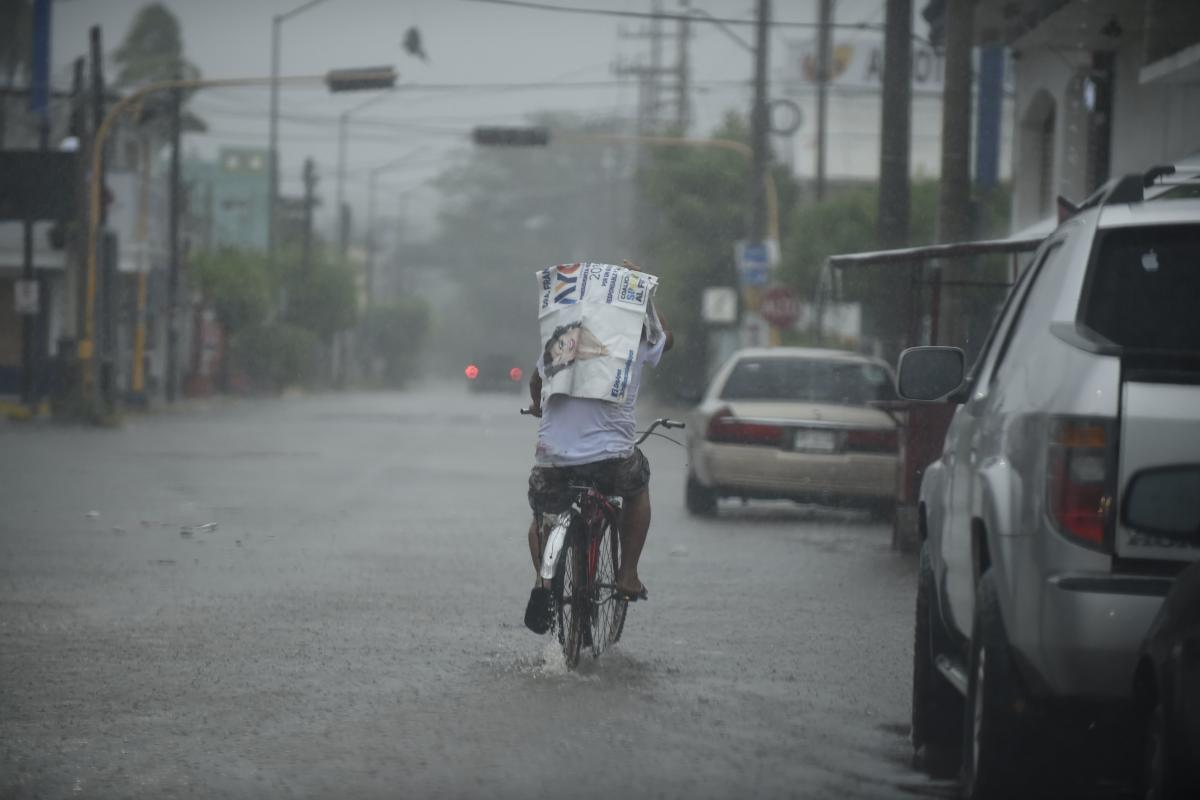 A man rides his bike along a street as Hurricane Willa arrives to Escuinapa, Sinaloa state on Tuesday.