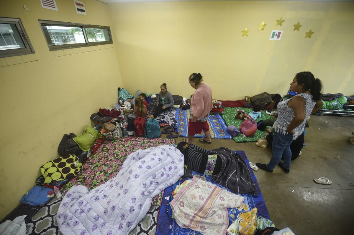 People remain at an improvised shelter in Escuinapa, Sinaloa state, on Tuesday.