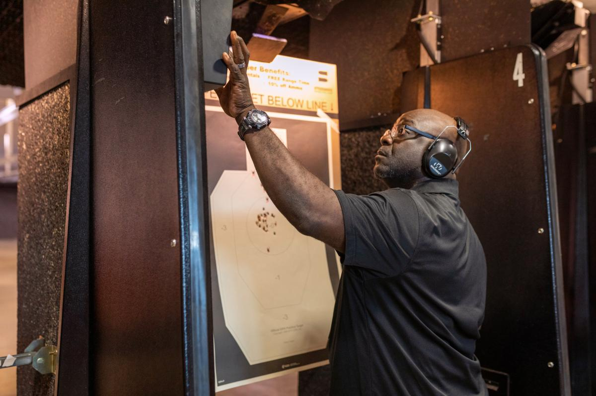 Colin Mapp examines his target in the gun range. About 24% of African Americans said they own guns according to 2017 study by Pew Research Center.