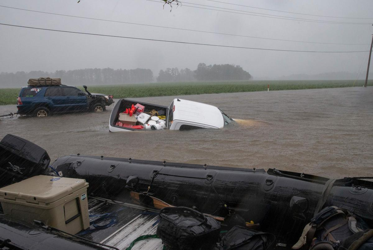 A pickup truck is submerged in floodwater on Saturday in Lumberton, North Carolina.