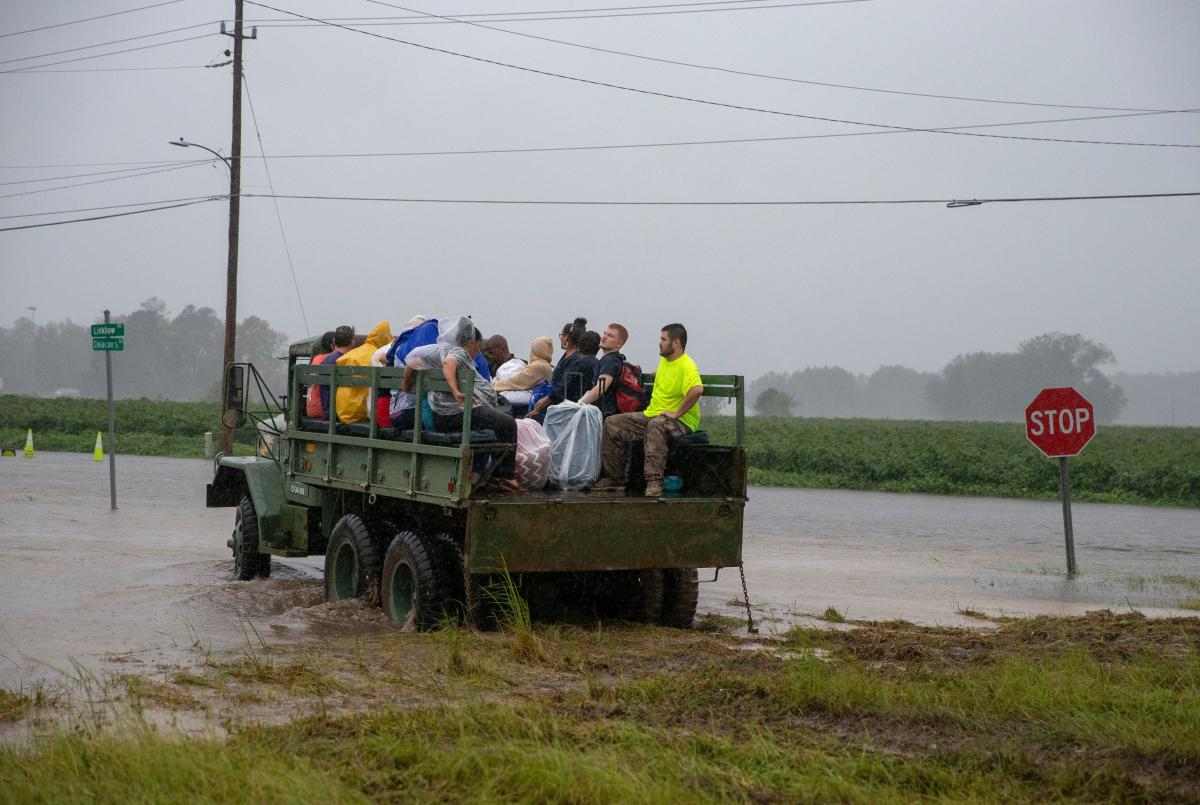 A truck transports nursing home staff and patients Saturday during the evacuation of a nursing home due to rising flood waters in Lumberton, N.C.