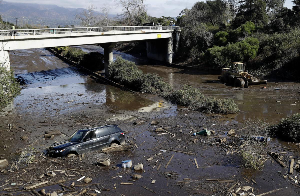 Debris sits stranded in flooded water on U.S. Highway 101 in Montecito, Calif., following a mudslide that killed 20 people in 2018.