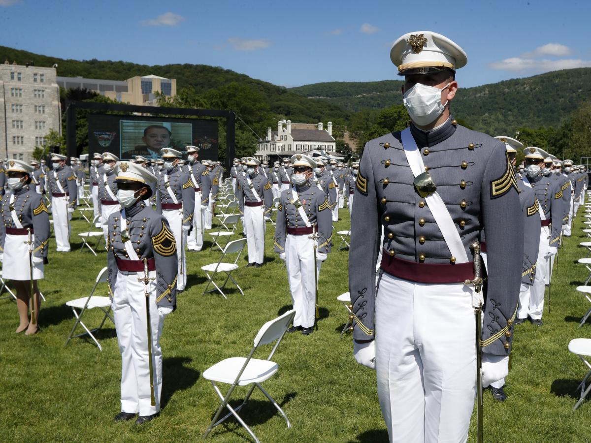 United States Military Academy graduating cadets wear face masks as they stand next to their socially-distanced seats during commencement ceremonies, Saturday, June 13.