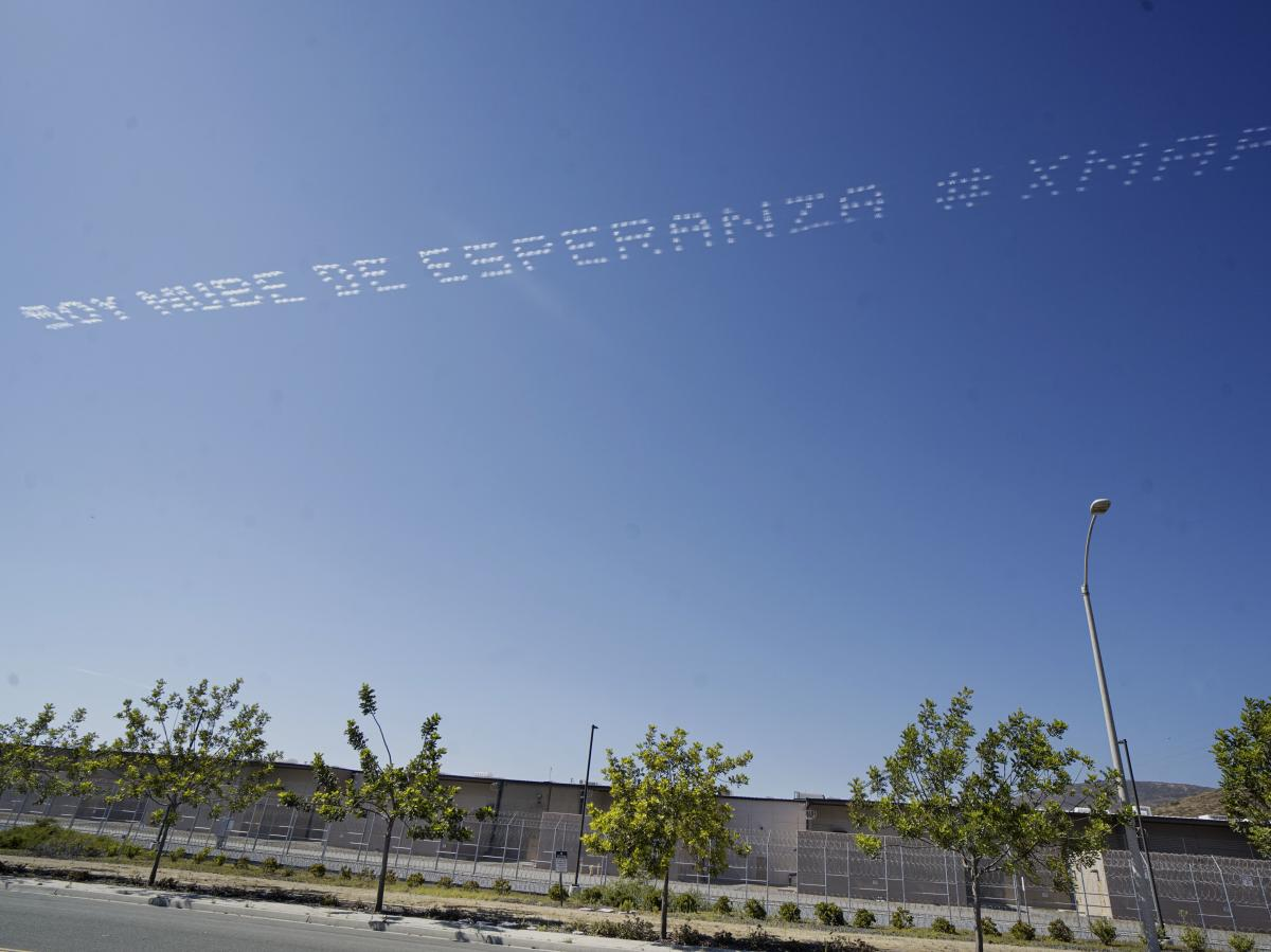 "The artist Marcos Erre Ramírez had the words ""Soy Nube De Esperanza,"" or ""I Am A Cloud Of Hope,"" flown over the Otay Mesa Detention Center in San Diego near the U.S. border with Mexico."