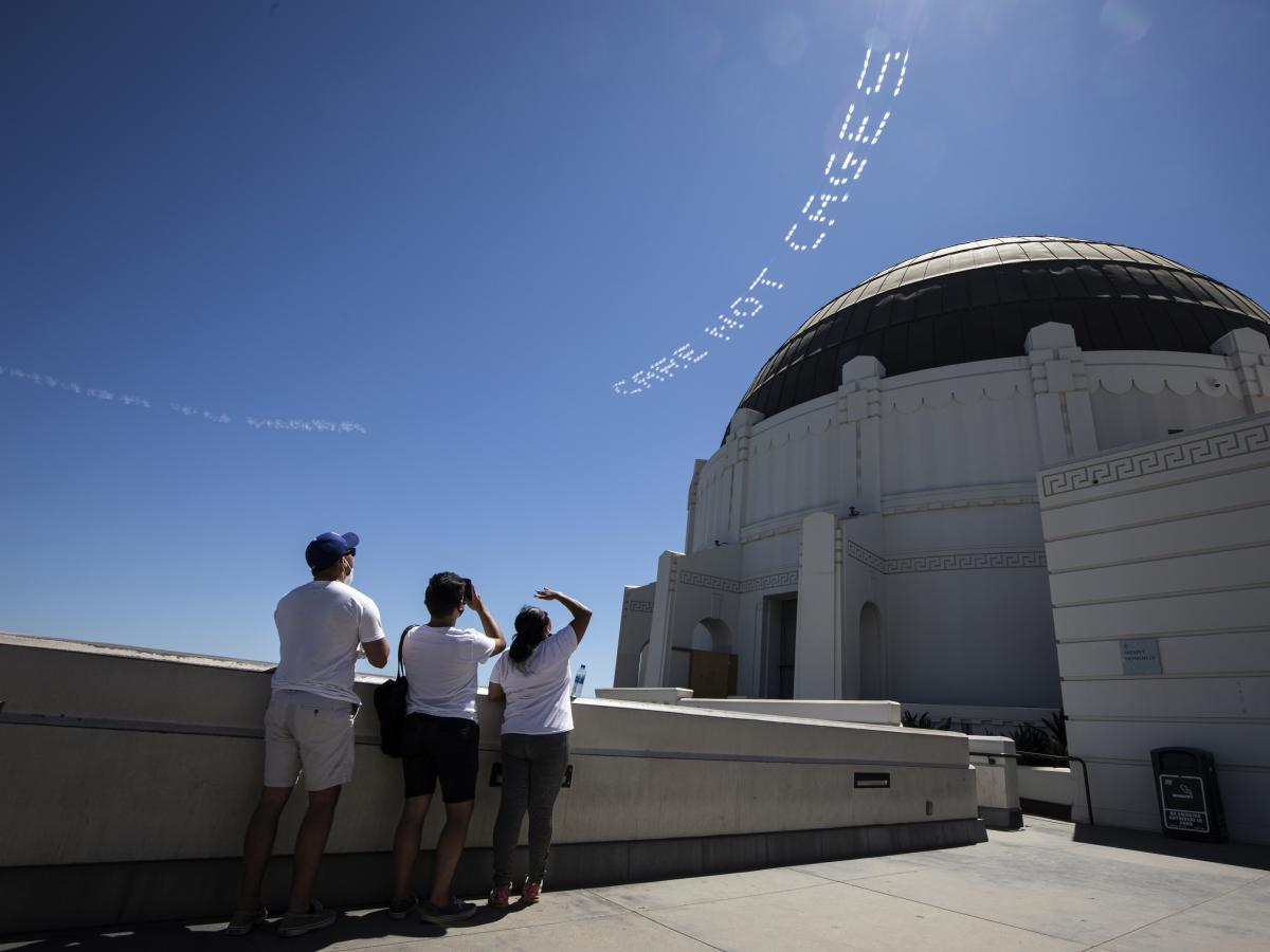 "The words ""Care, not cages"" are viewed from the Griffith Observatory in L.A. The activist Patrisse Cullors had them flown over the city's Men's Central Jail. ""What we are challenging the county to do right now is to actually invest into our communities th"