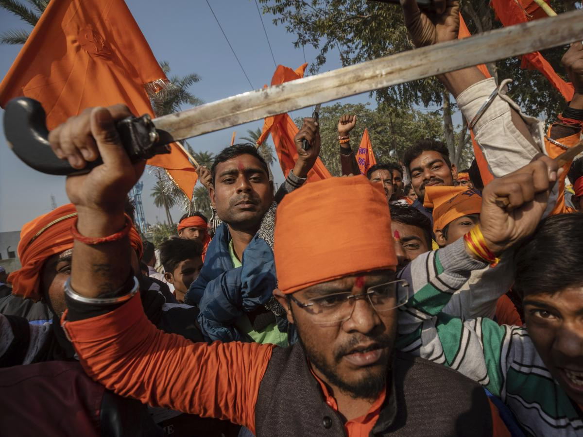 Hindu hard-liners, one holding a sword, chant slogans against Muslim communities during a Nov. 25, 2018, rally demanding a Hindu temple be built on a site in Ayodhya, where attackers in 1992 demolished a 16th century mosque.