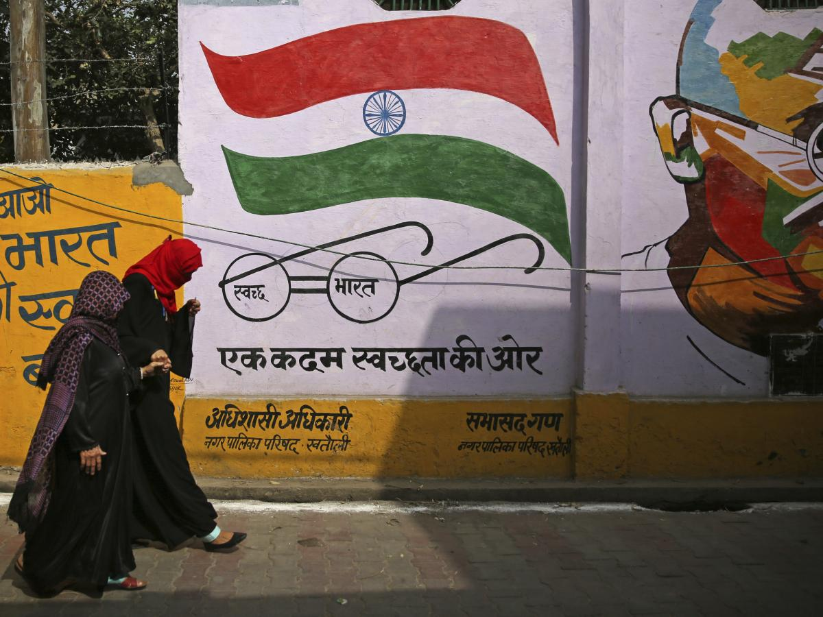 Muslim women leave a polling station after casting their votes in Khatauli, Uttar Pradesh, India, on Thursday. Uttar Pradesh, India's most populous state, is led by a Hindu priest and has banned the consumption of beef and changed some city names to refle