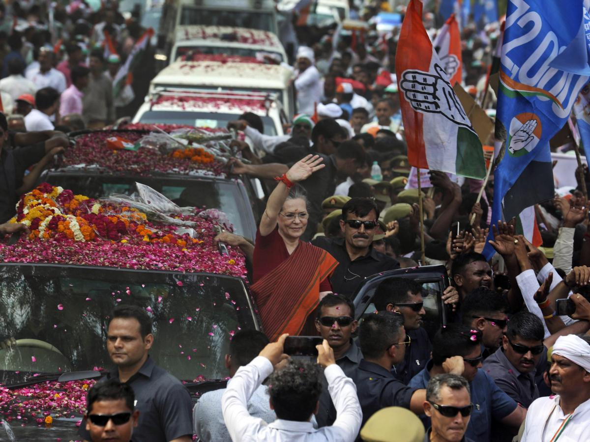 India's opposition Congress party leader Sonia Gandhi (center) waves as she arrives to file her nomination papers for elections, in Rae Bareli, Uttar Pradesh, India, on Thursday. The Congress party dominated Indian politics for much of the country's histo