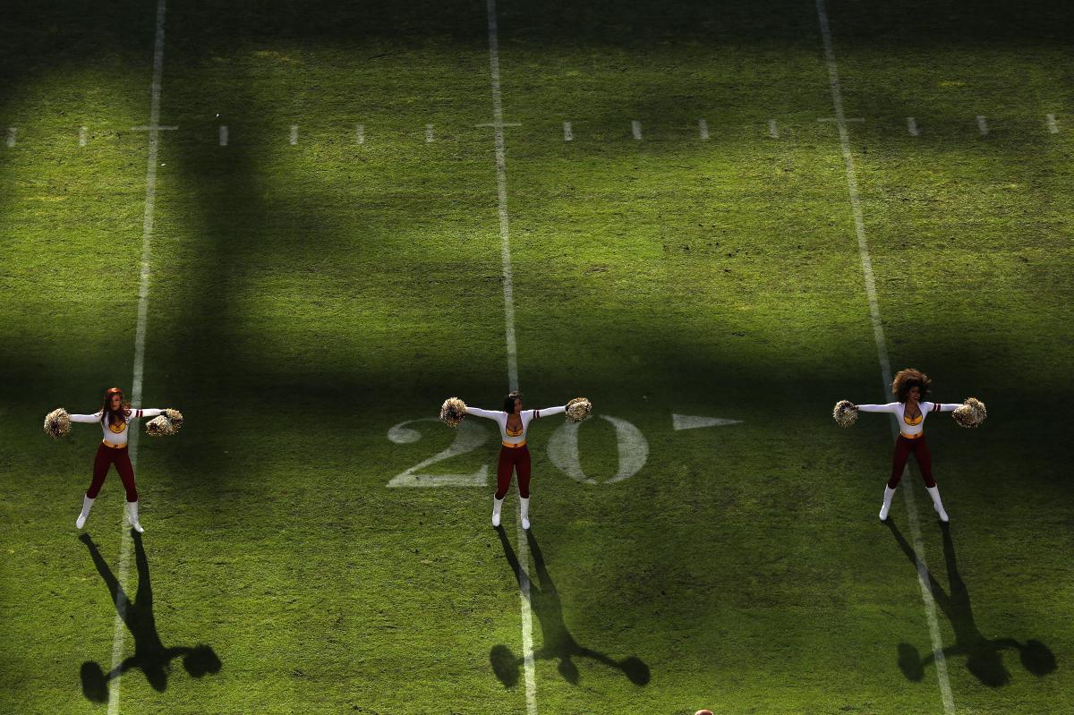 Washington Football Team cheerleaders perform as their team plays against the Philadelphia Eagles at FedExField in Maryland on Dec. 15, 2019.