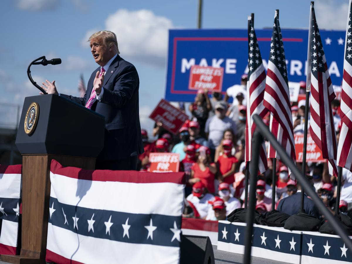 President Trump speaks during a campaign rally in Lumberton, N.C. He has played down the pandemic and played up the size of his rallies.