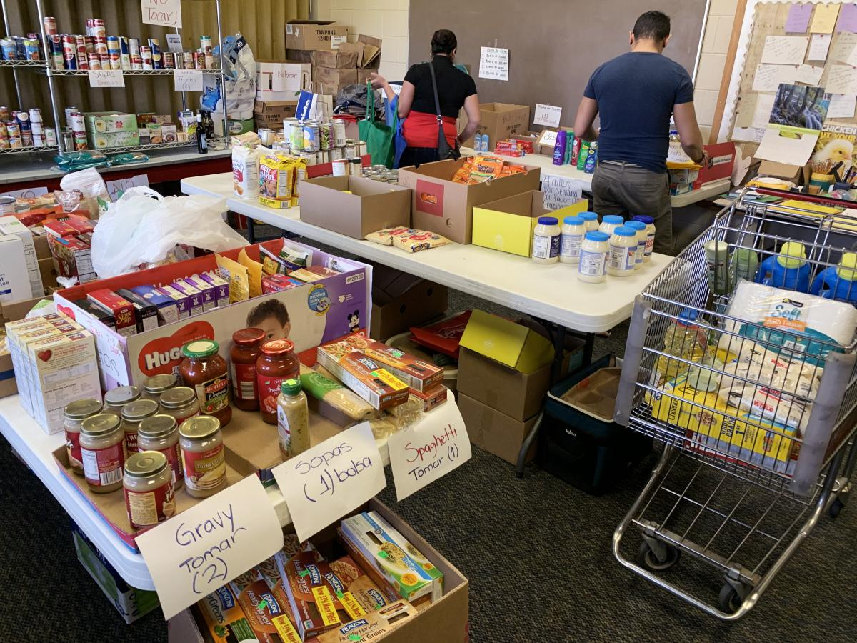 A food pantry was set up at First Presbyterian Church to help feed the men, who aren't permitted to work legally, and their families.