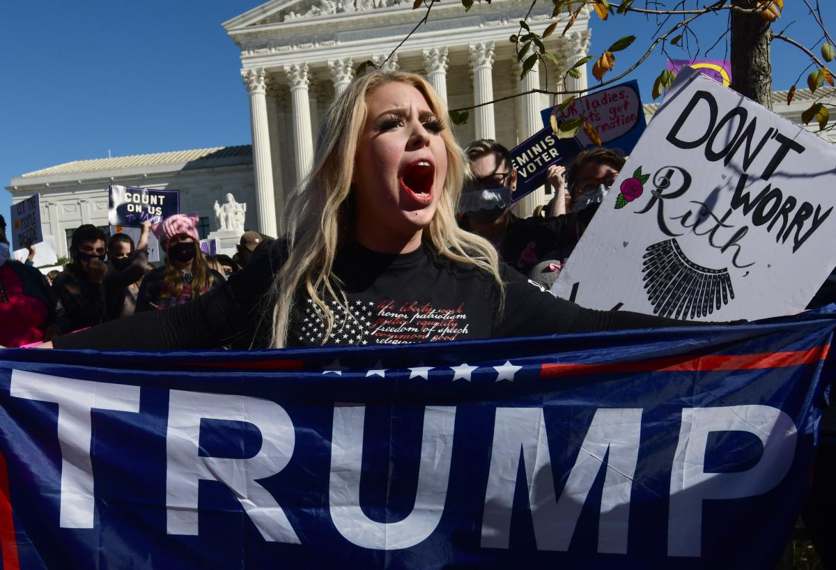 Isabella De Luca, a Trump supporter from New York has a bloodied mouth after a scuffle at the Women's March in Washington D.C.