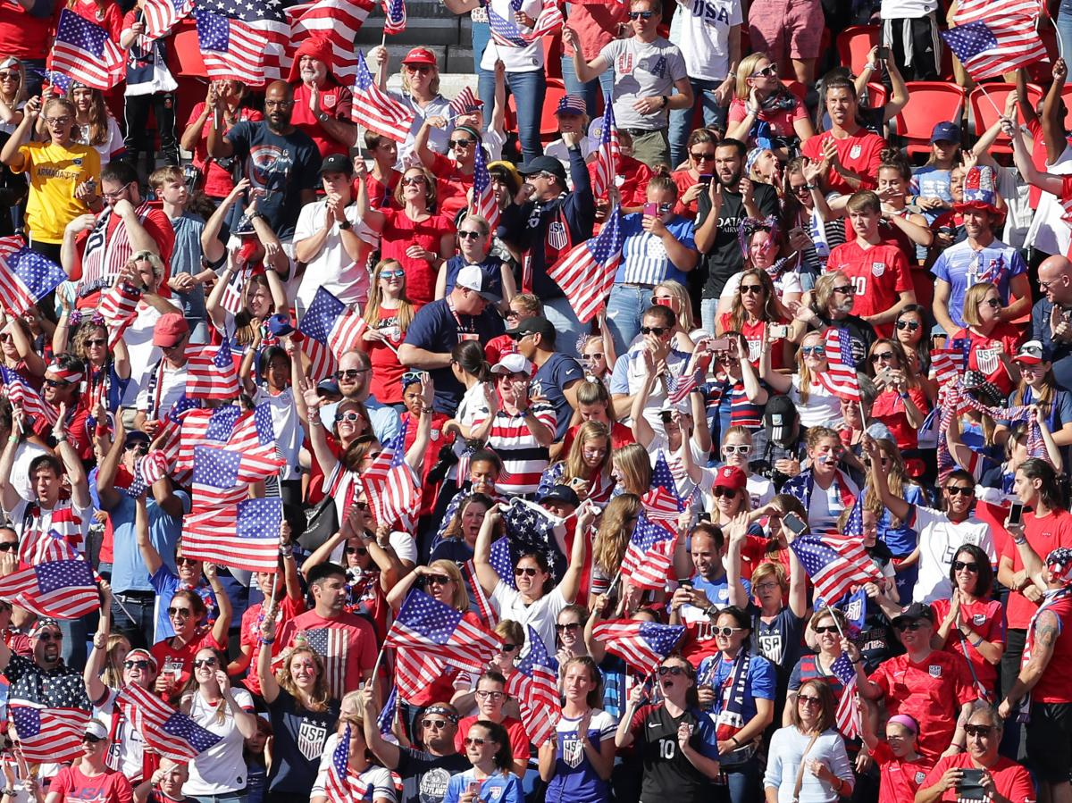 U.S. fans celebrate during their team's victory over Chile at Parc des Princes on Sunday in Paris.