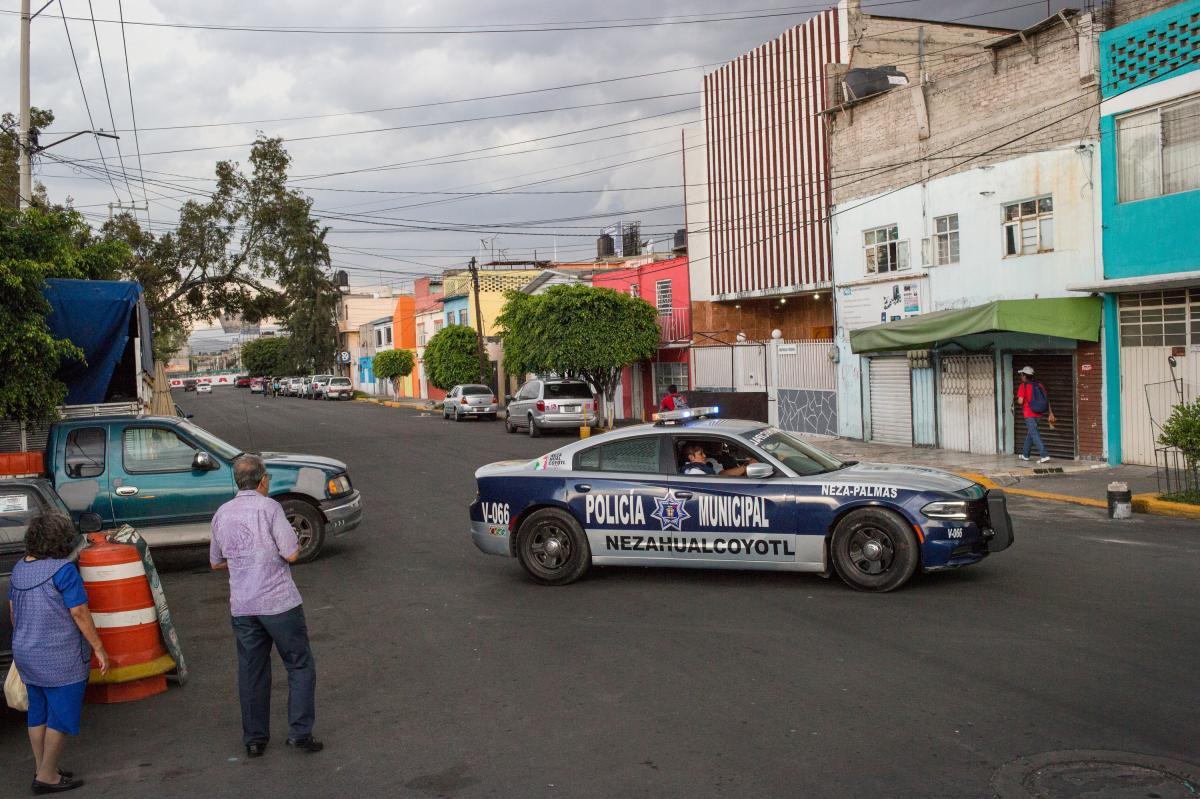 Police drive through Ciudad Nezahualcóyotl, Mexico state.