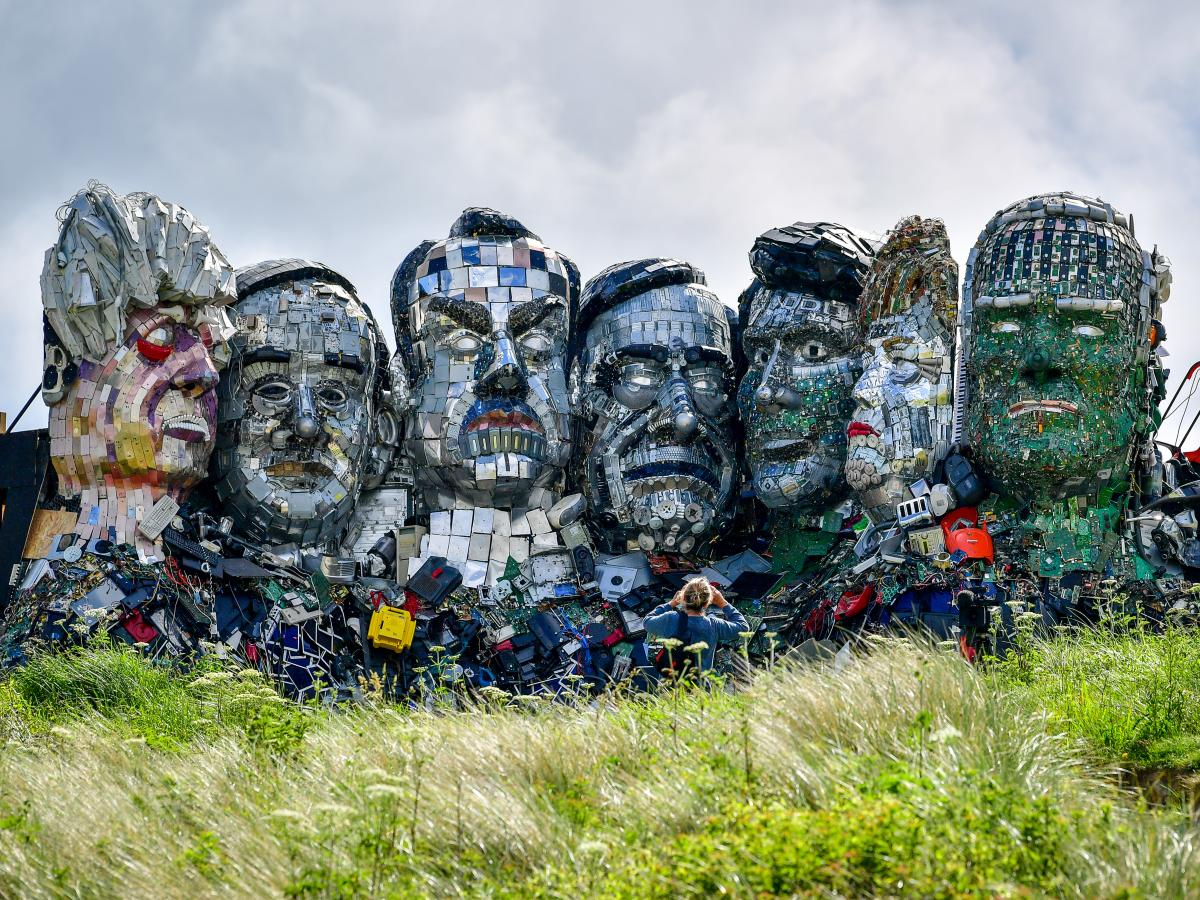 """The """"Mount Recyclemore"""" sculpture depicting G-7 leaders is made from electronic waste. Artist Joe Rush created the sculpture to highlight the damage caused by disposal of electronic devices. It's been erected near the G-7 summit."""