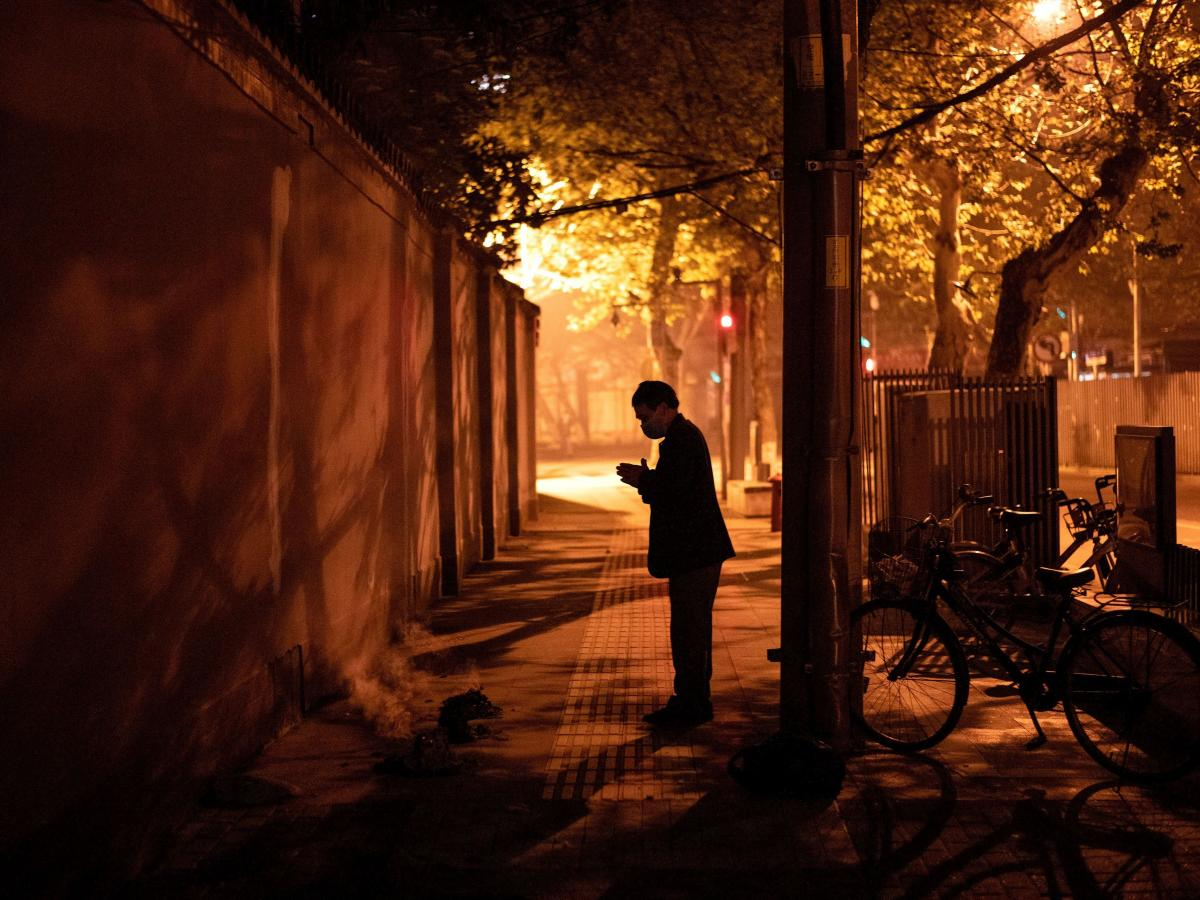 A resident of Wuhan prays after burning paper offerings during the Tomb Sweeping festival, also known as Qingming festival, on April 4, 2020, a holiday to honor ancestors. Last year, a China called for a 3-minute silence on this day to mourn patients and