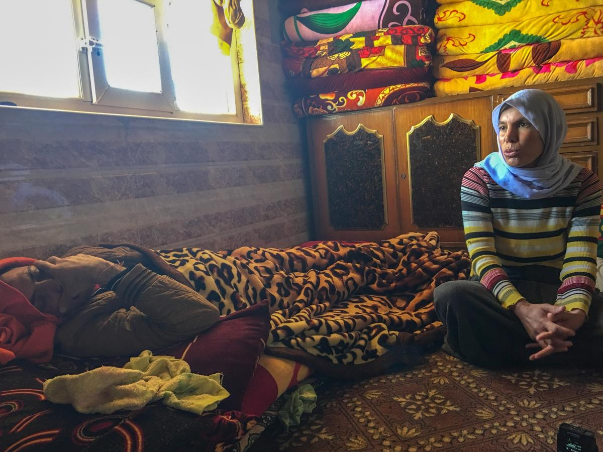 Shireen Hassam, whose 2-year-old daughter died in January of malnutrition and dehydration. Her husband Osman Barkat, lying down, was wounded in an explosion near Sinjar in December.