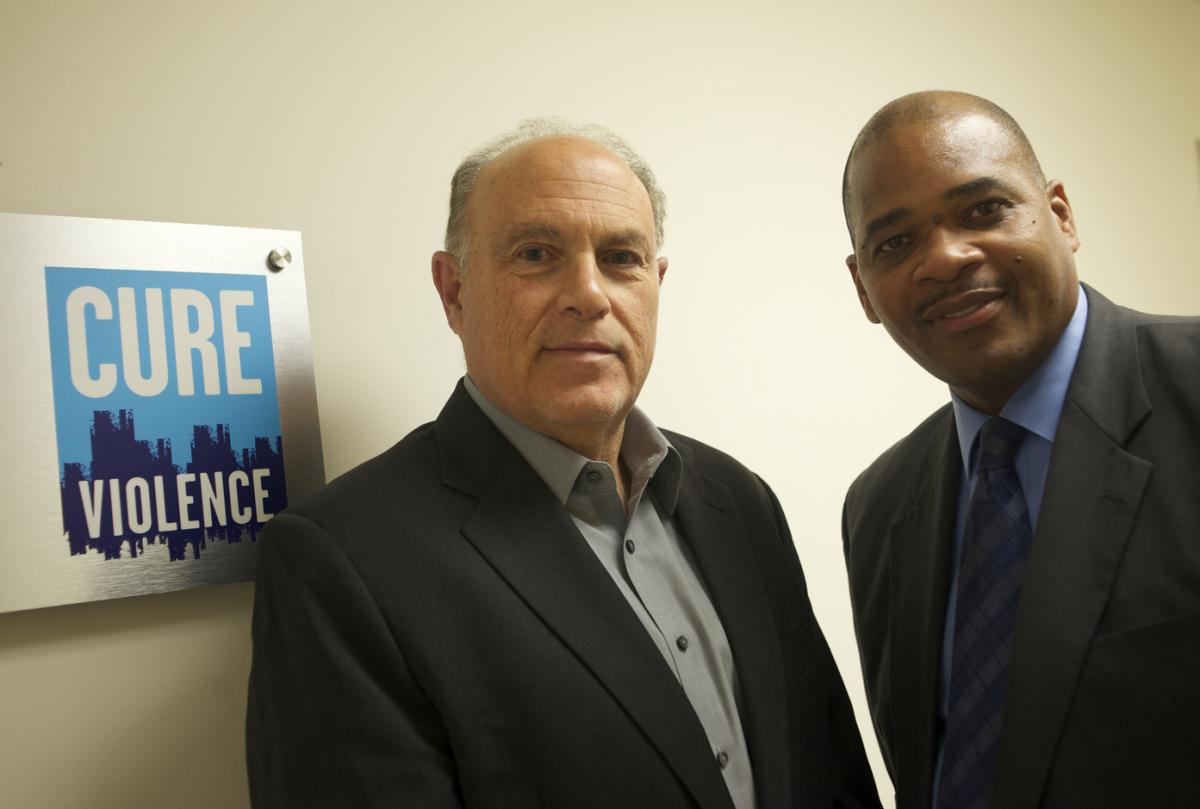 """Dr. Gary Slutkin (left) and Autry Philips team up to """"interrupt"""" violence."""