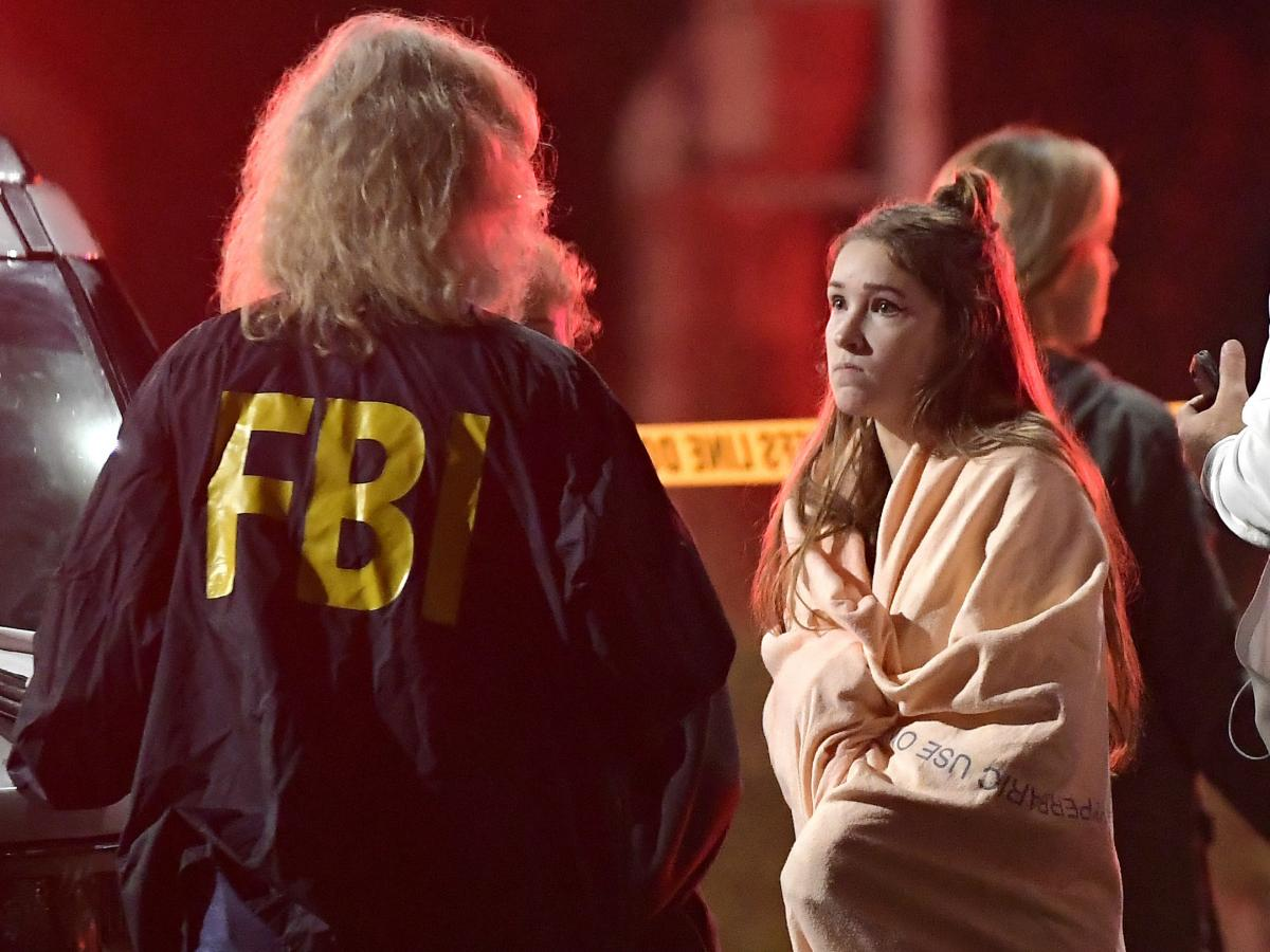 "An FBI agent talks to a potential witness to the shooting at the Borderline Bar and Grill in Thousand Oaks, Calif., where a gunman opened fire inside the country dance bar on ""college night."""
