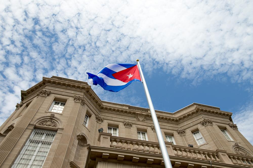 The Cuban flag is raised over their new embassy in Washington, on Monday. Cuba's blue, red and white-starred flag was hoisted Monday at the country's embassy in Washington in a symbolic move signaling the start of a new, post-Cold War era in U.S.-Cuba rel