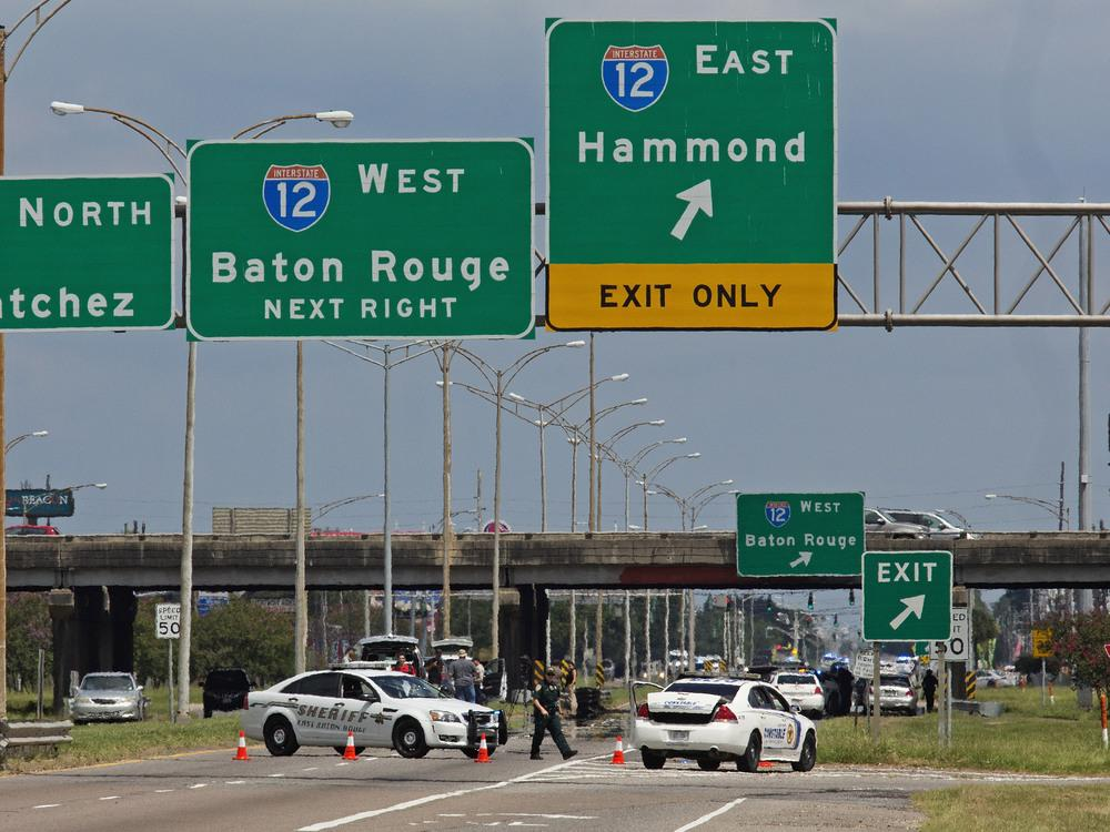 Baton Rouge police block Airline Highway after police were shot in Baton Rouge, La., Sunday, July 17, 2016. Authorities in Louisiana say several law enforcement officers are dead, and several injured in Baton Rouge after on-duty law enforcement officers w