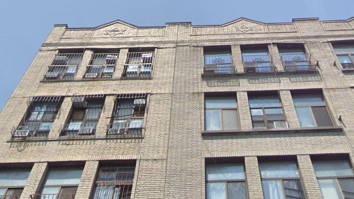 The exterior of the condo building at 165 Henry St. in Manhattan's Lower East Side hints at the split-level apartments inside, as air conditioners (upper left) are positioned at both the upper and lower windows of the top two floors.