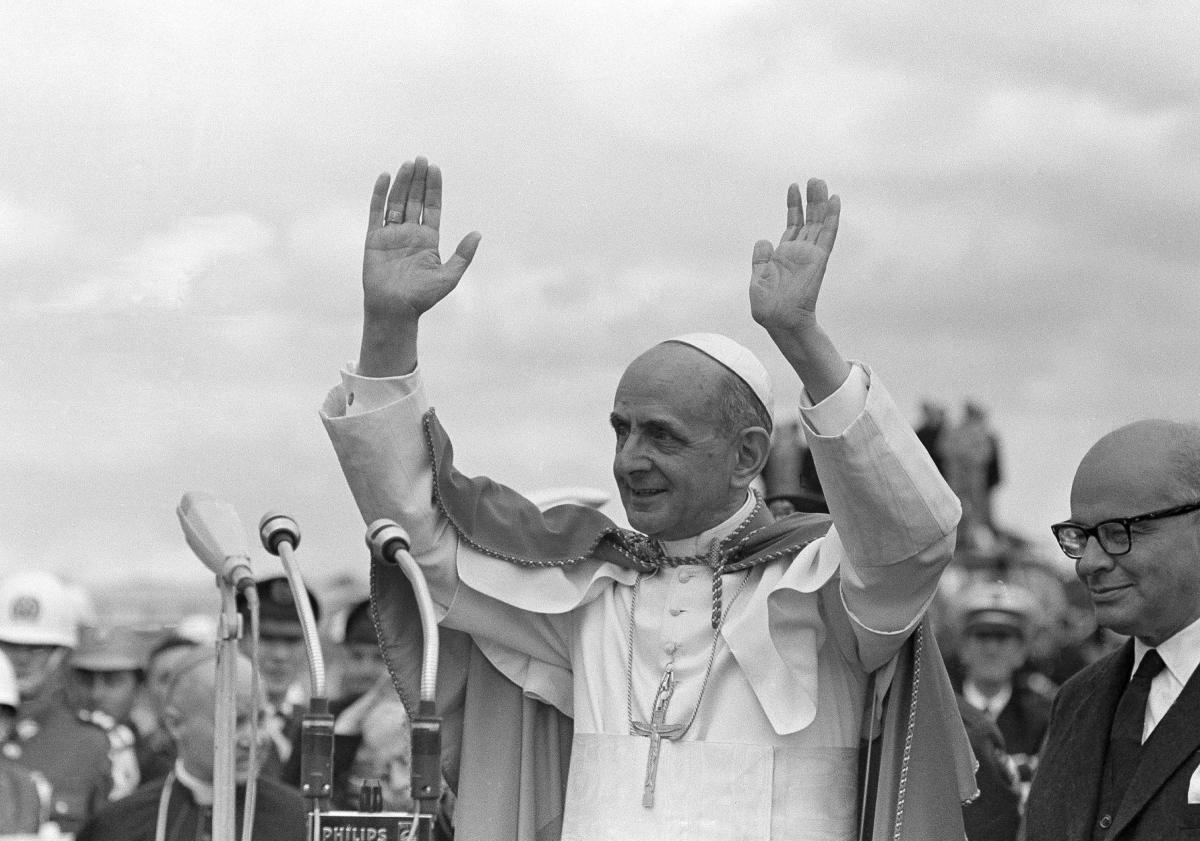 Pope Paul VI acknowledges cheers as standing on platform in Bogota, Colombia, on Aug. 22, 1968.