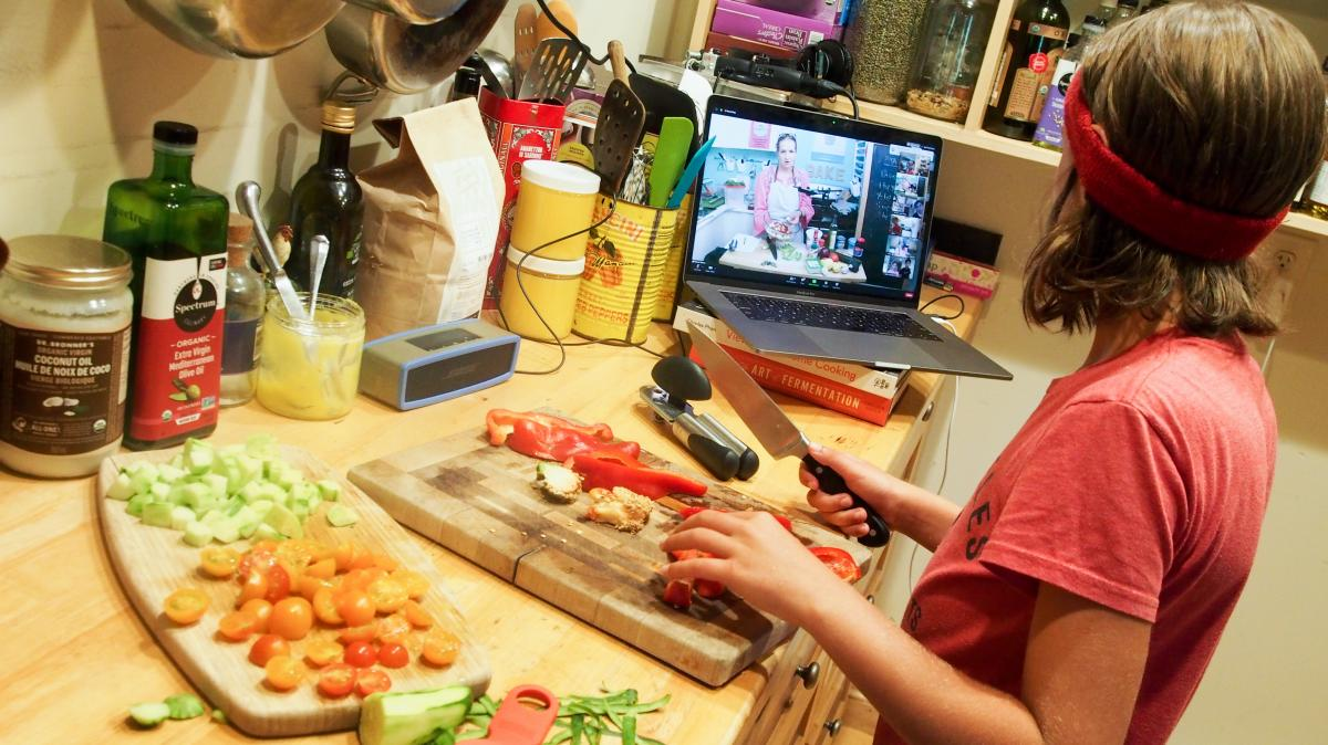 Wiley James, 10, prepares a meal as part of an online cooking camp run by a chef in Austin, Texas.
