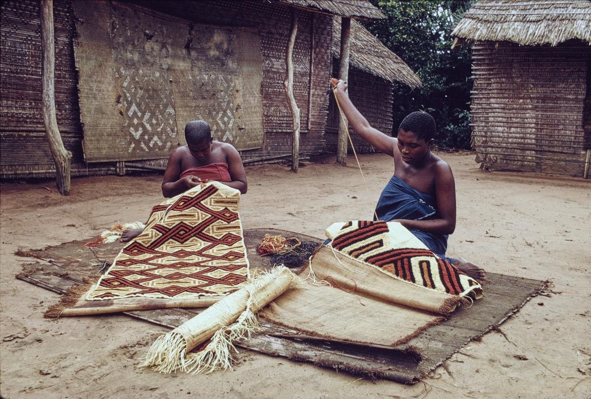 Kuba women decorating woven cloth in the Democratic Republic of the Congo, photographed in 1970. In the past, women were the main creators of the legendary Kuba textiles.