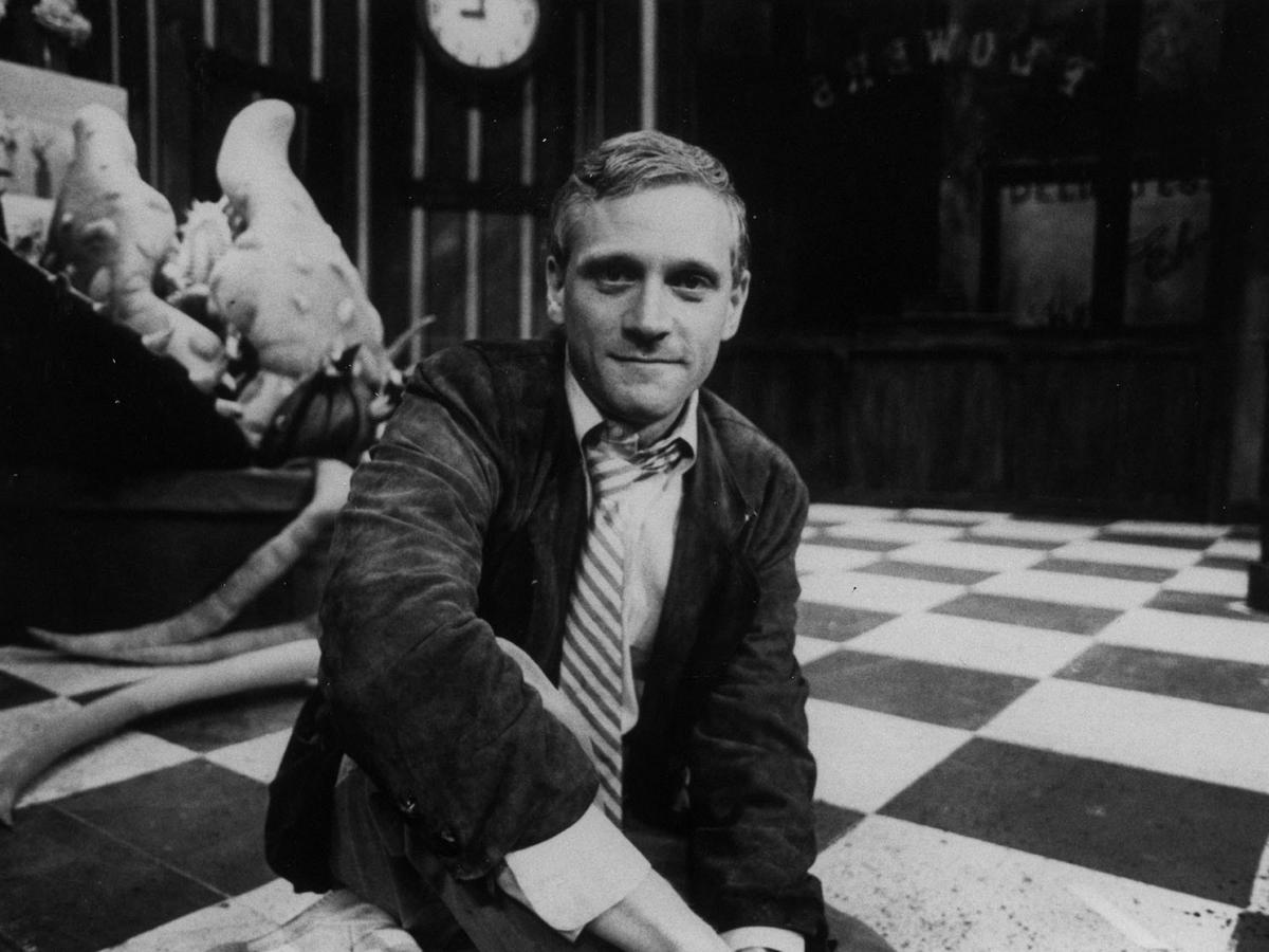 A young Howard Ashman, photographed on the set of his musical Little Shop of Horrors.