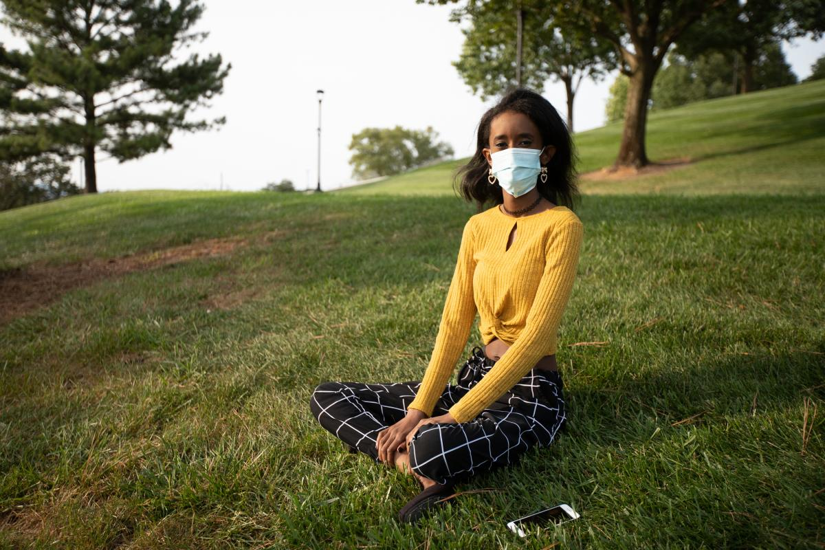 Huda Mohamed, a student at James Madison University in Harrisonburg, Va., has an immunodeficiency. She decided to take extra precautions by using Virginia's COVIDWISE app, which alerts users who may have been exposed to the coronavirus. Such apps are only
