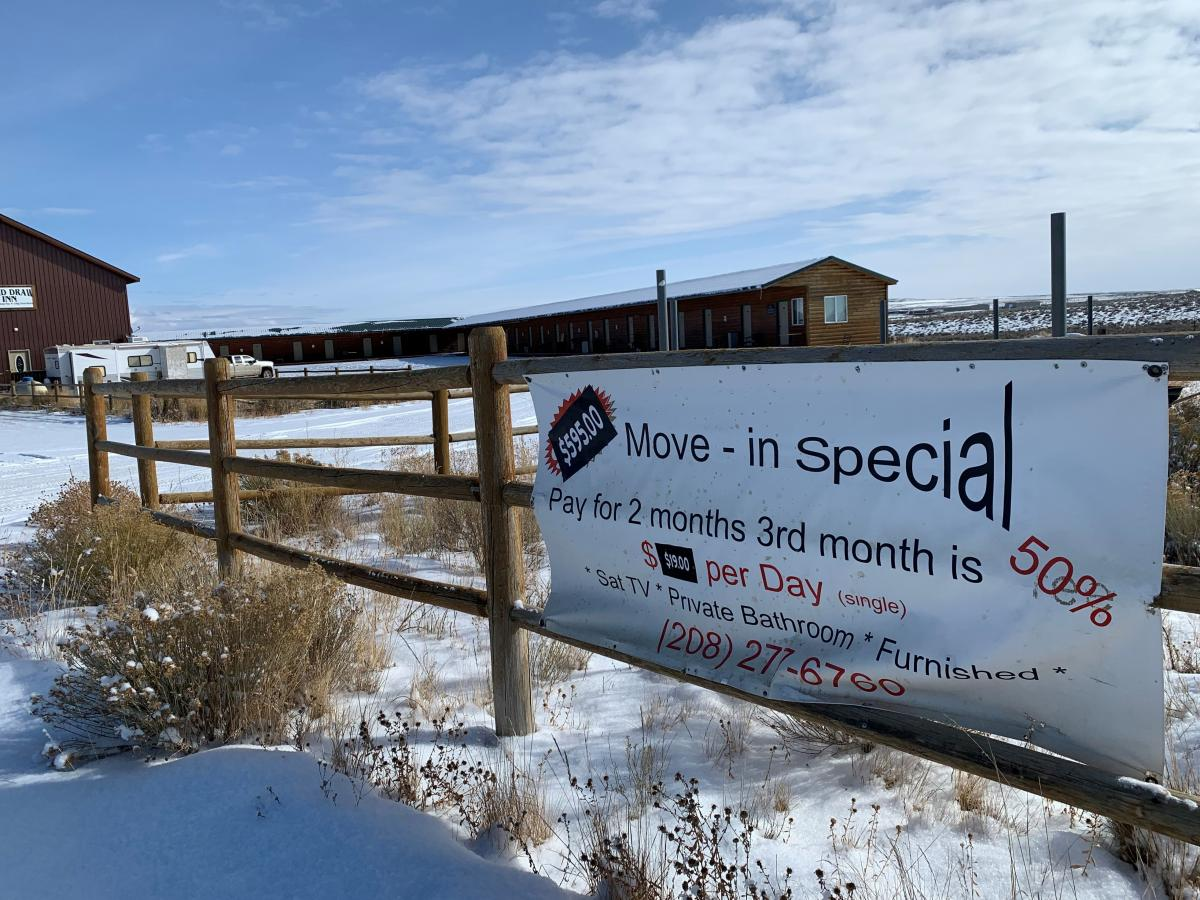 A sign in the Jonah Field advertises cheap rates at a deserted motel built for oil and gas workers.