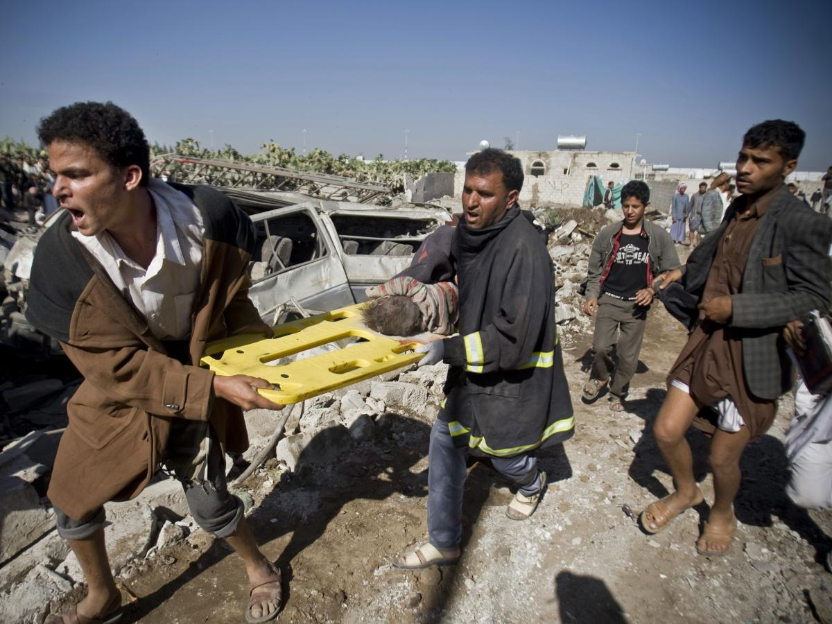After Saudi airstrikes in Sanaa, Yemen in 2015, people carry the body of a child uncovered from under the rubble. The United Nations has declared Yemen the world's worst humanitarian crisis. When Yemen's war began, Nageeb Alomari decided to bring his wife