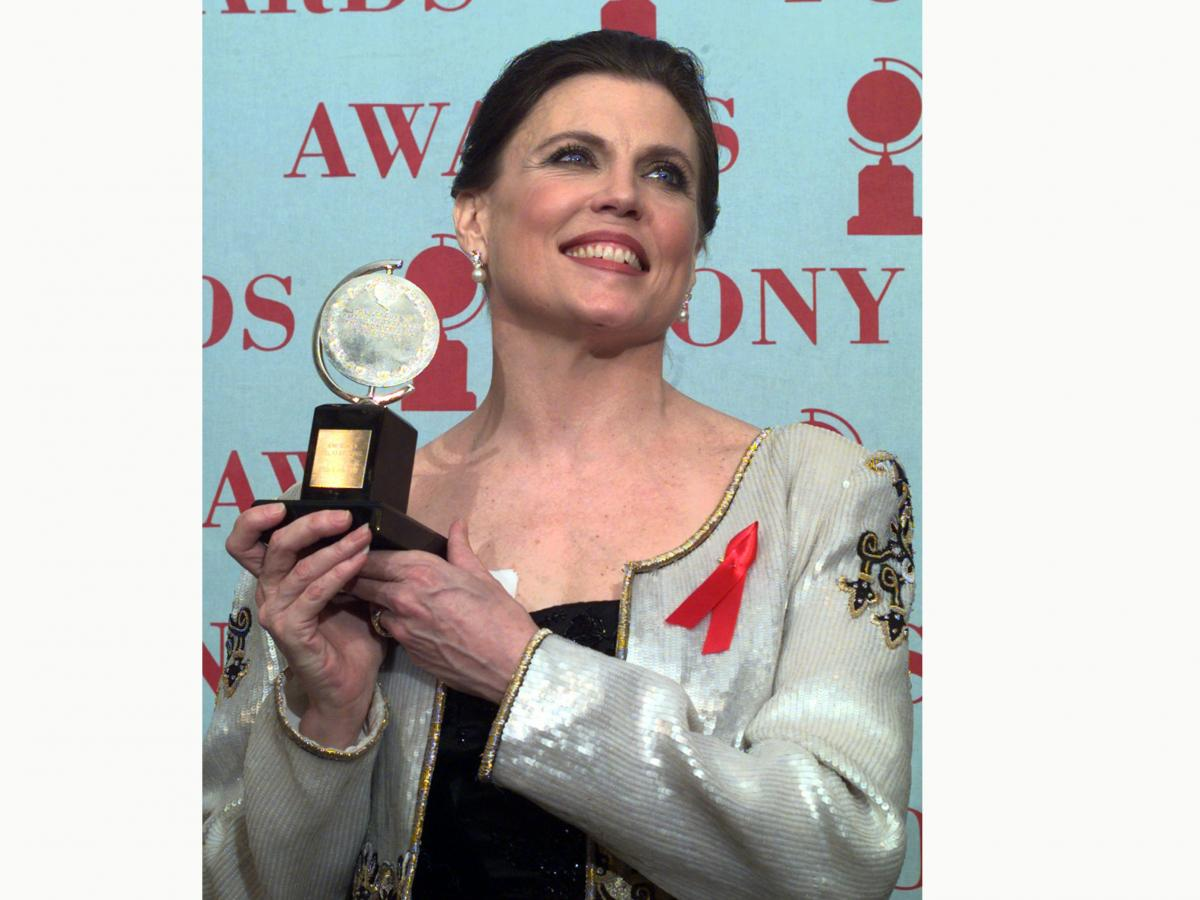 Ann Reinking, pictured holding her Tony Award for best choreography for the musical Chicago in 1997, died on Saturday, her family said in a statement.