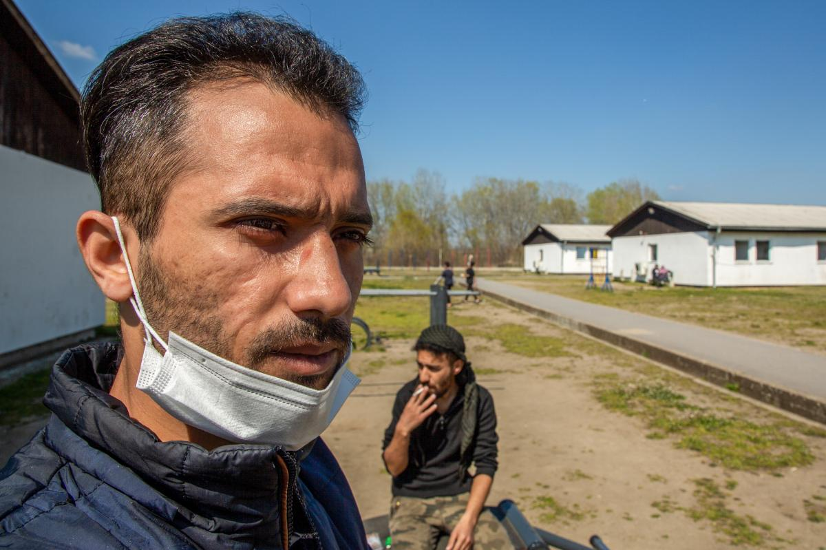 Mohammad al-Muhammad (left) and Hatem al-Hamad in the Krnjaca asylum center in Serbia. Muhammad fled his home in Syria and managed to cross into Romania in December. He says he lost 85% of his eyesight after Romanian police caught him and beat him with a