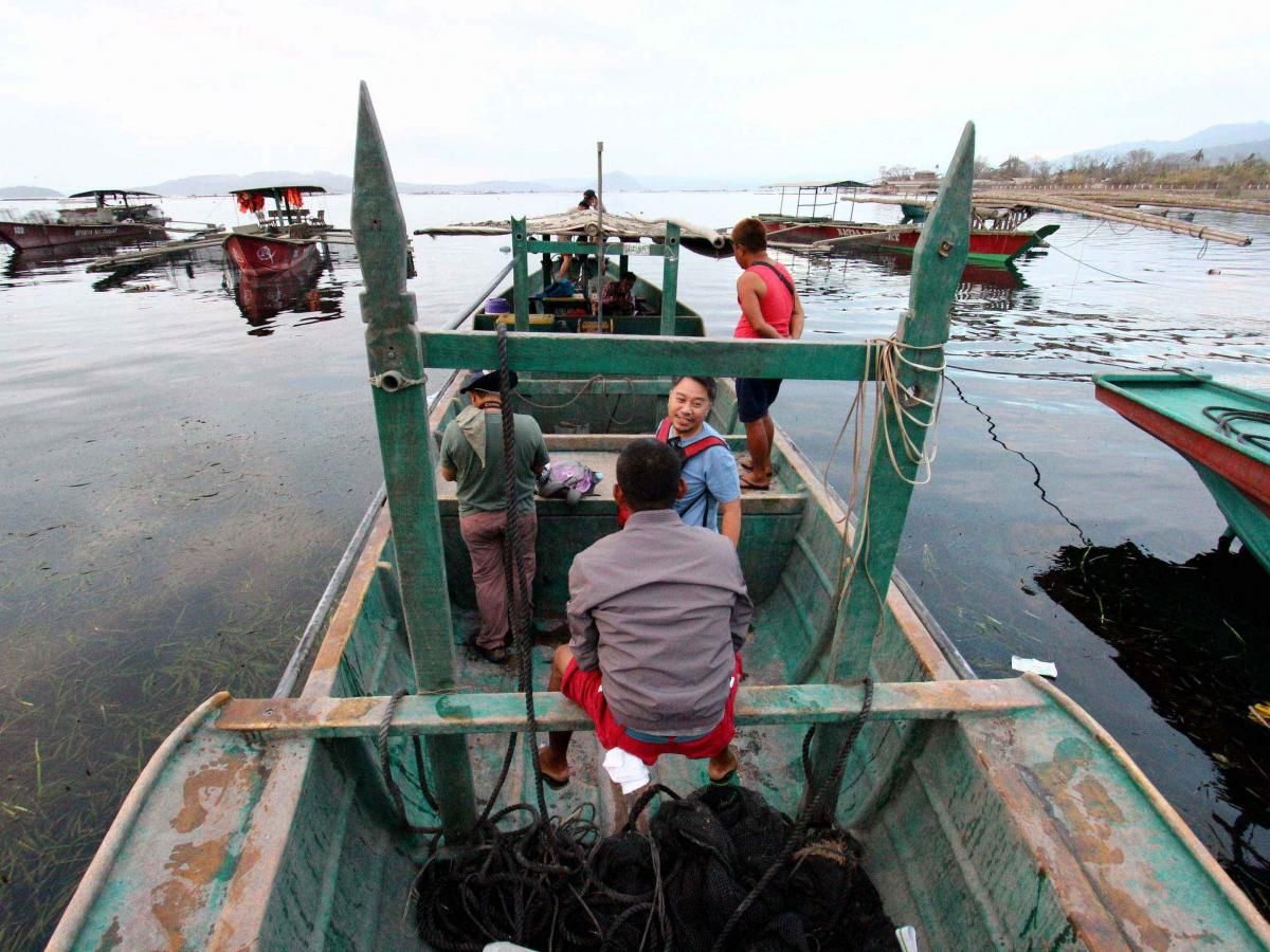 Fishermen head to Taal Volcano Island to rescue their horses and other livestock in Talisay, Batangas, on Sunday.