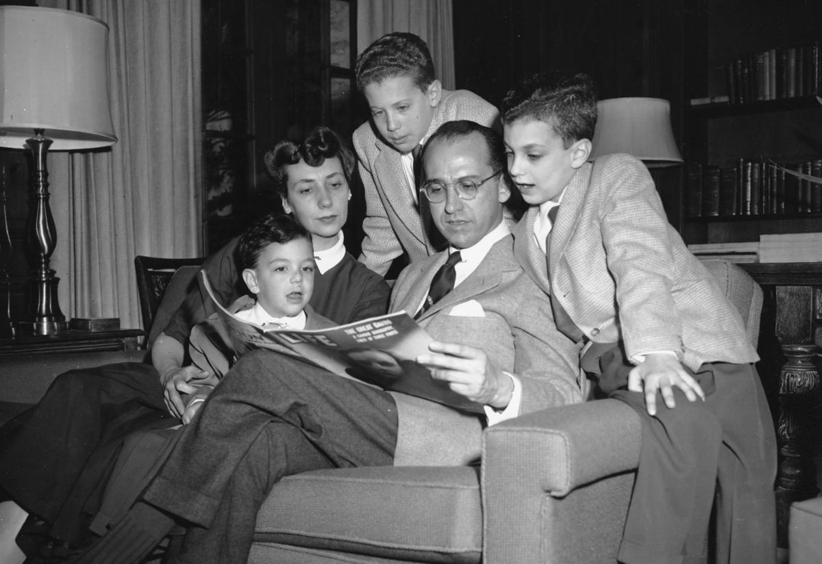 Dr. Jonas E. Salk, who discovered the polio vaccine, reads with his wife and three boys in Ann Arbor, Mich., on April 11, 1955. The boys were among the first vaccinated during testing. The family was photographed the night before an announcement the vacci