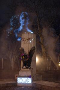 An art collective installed an Edward Snowden projection in a Brooklyn park Monday night, after a bust of Snowden was removed by authorities park earlier that day.