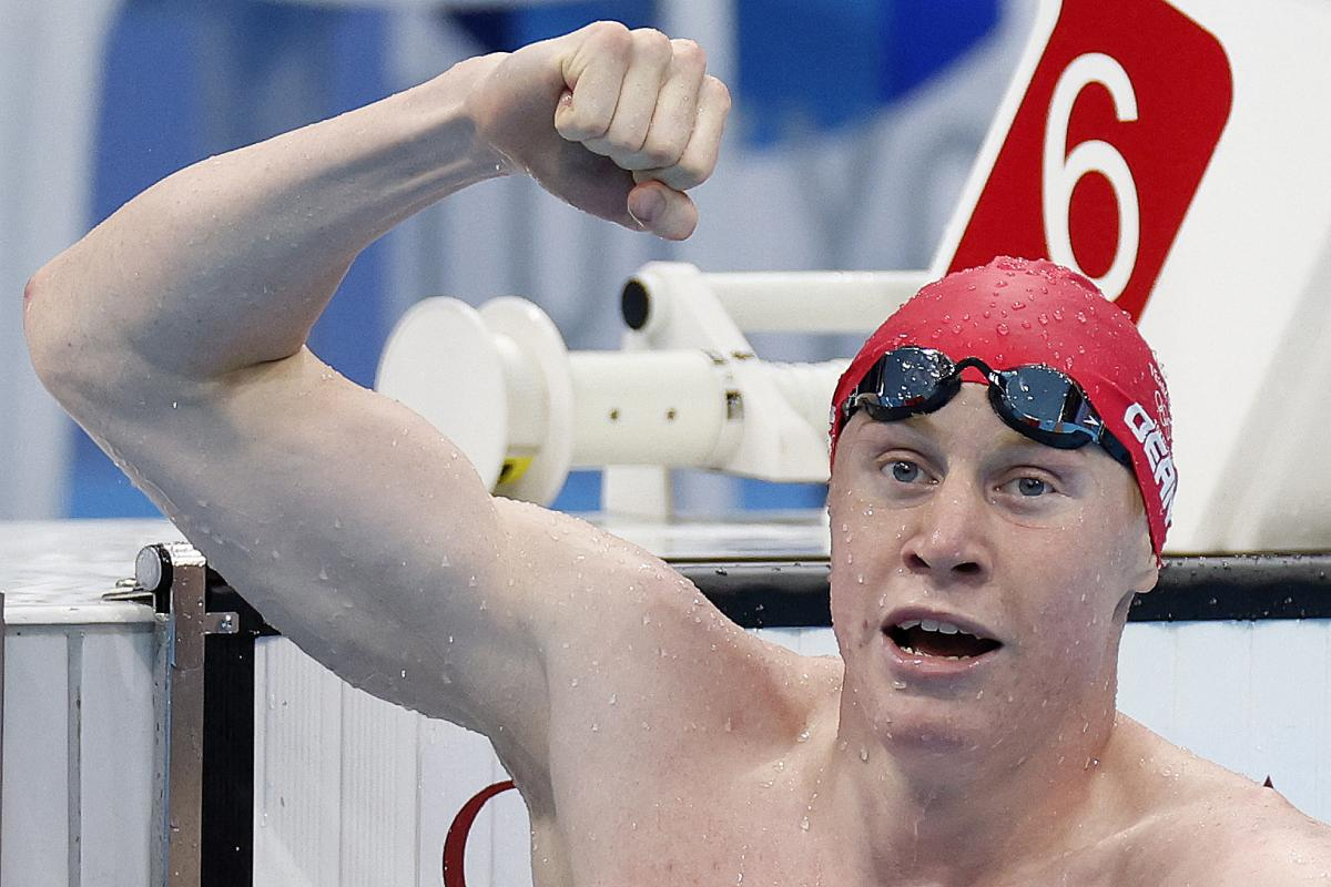Britain's Tom Dean celebrates winning gold in the men's 200-meter freestyle swimming event at the Tokyo Olympics on Tuesday.