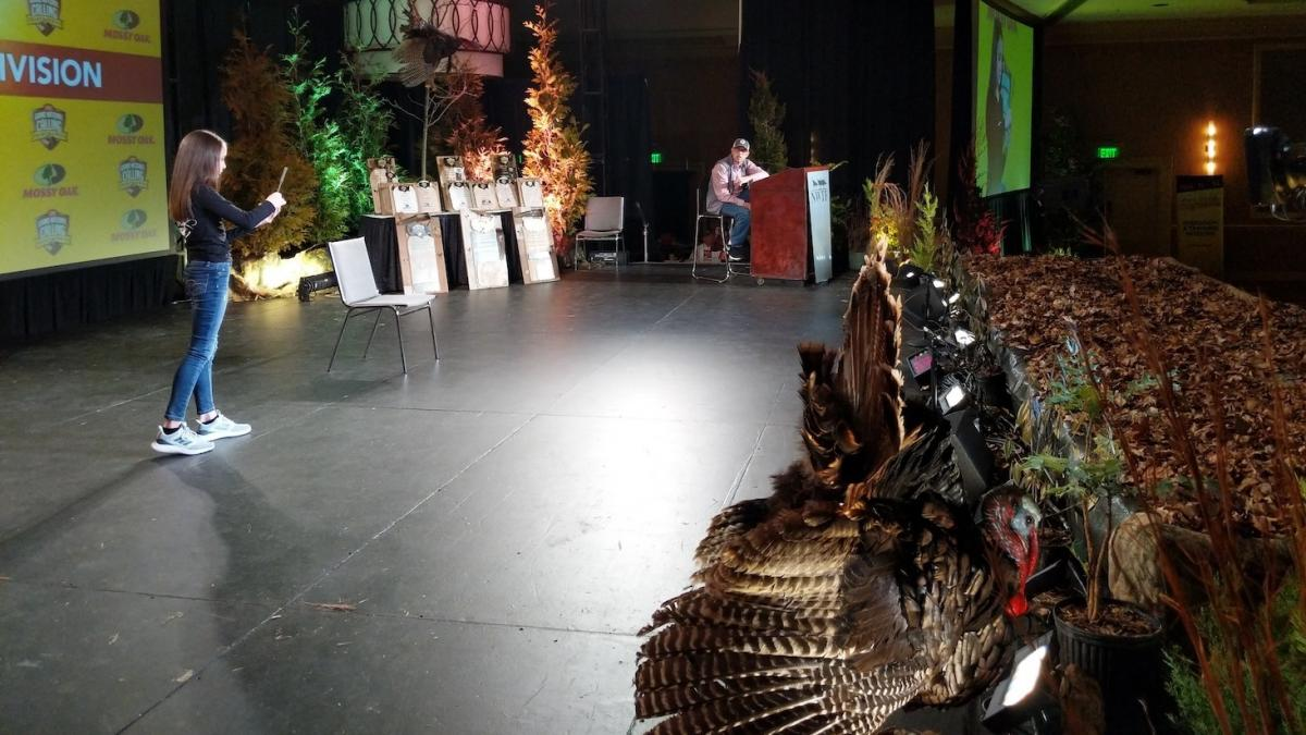 Brooke Simpson, age 10, makes a turkey call on stage at the Grand National Calling Championships in Nashville on Feb. 14.